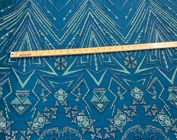 Teal multi color geometric design with heavy beaded and sequins on a mesh lace-prom-nightgown-sold by the yard.