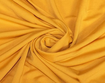 """Yellow 58/59"""" Wide ITY Fabric Polyester Knit Jersey 2 Way  Stretch Spandex Sold By The Yard."""