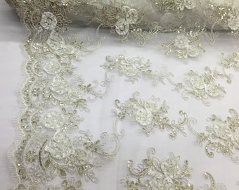 Ivory 3d flowers embroider with sequins on a ivory mesh lace. Wedding/bridal/prom/nightgown fabric. Sold by the yard.