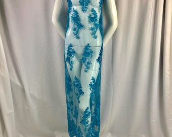 Elegant turquoise hand beaded floral design embroider with sequins on  a mesh lace-dresses-fashion-prom-nightgown-sold by yard.