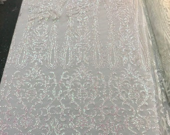 White Iridescent glitter damask design on a mesh lace-dresses-fashion-decorations-prom-nightgown-sold by the yard.