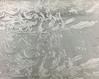 White rhinestone vines embroider on a mesh lace fabric sold by yard