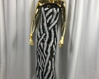 Black-white feathers design embroider with shiny-matt sequins on a 4 way stretch power black mesh-dresses-prom-nightgown-sold by the yard.
