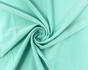 """Mint Green 58/59"""" Wide ITY Fabric Polyester Knit Jersey 2 Way  Stretch Spandex Sold By The Yard."""