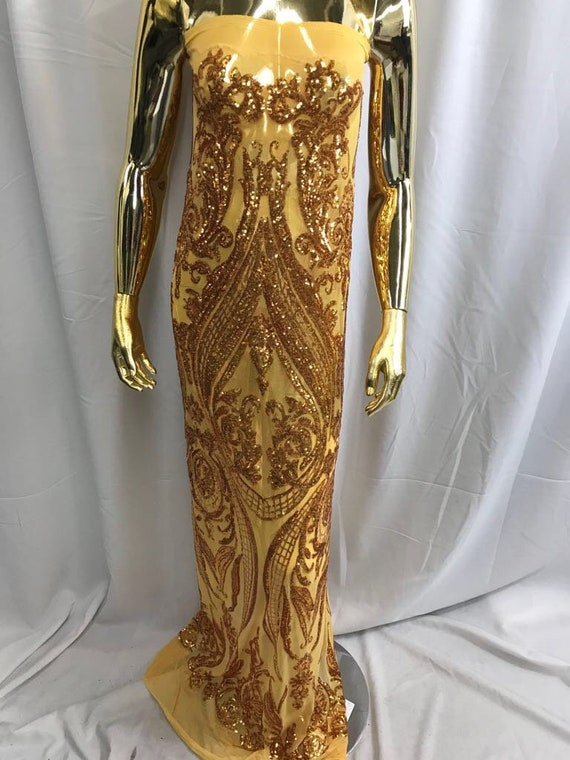 Gold empire design embroider with shiny sequins on a 4 wY stretch power mesh-dresses-fashion-apparel-prom-nightgown-sold by yard.