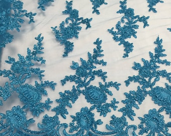 Turquoise appwaling flower design emboider and beaded on a mesh lace-prom-nightgown-decorations-dresses-sold by the yard.