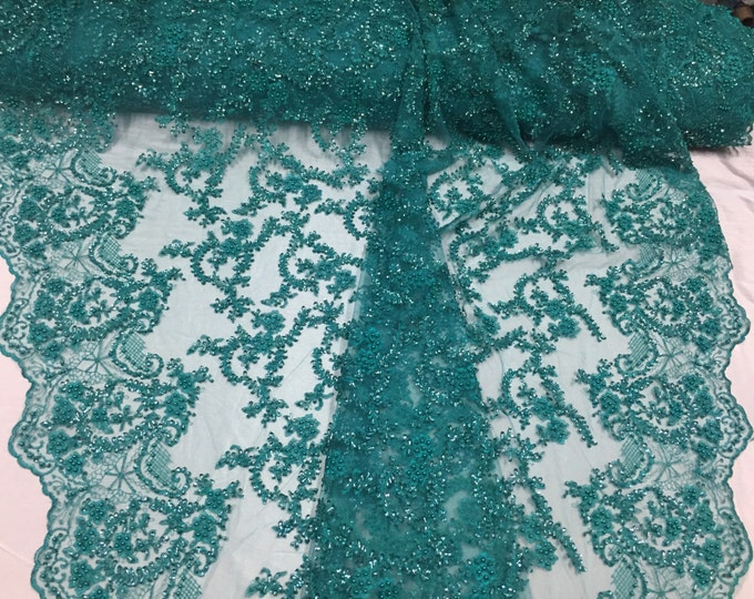 Majestic jade shinny vine design embroider and heavy beaded on a mesh lace-prom-nightgown-decorations-dresses-sold by the yard.