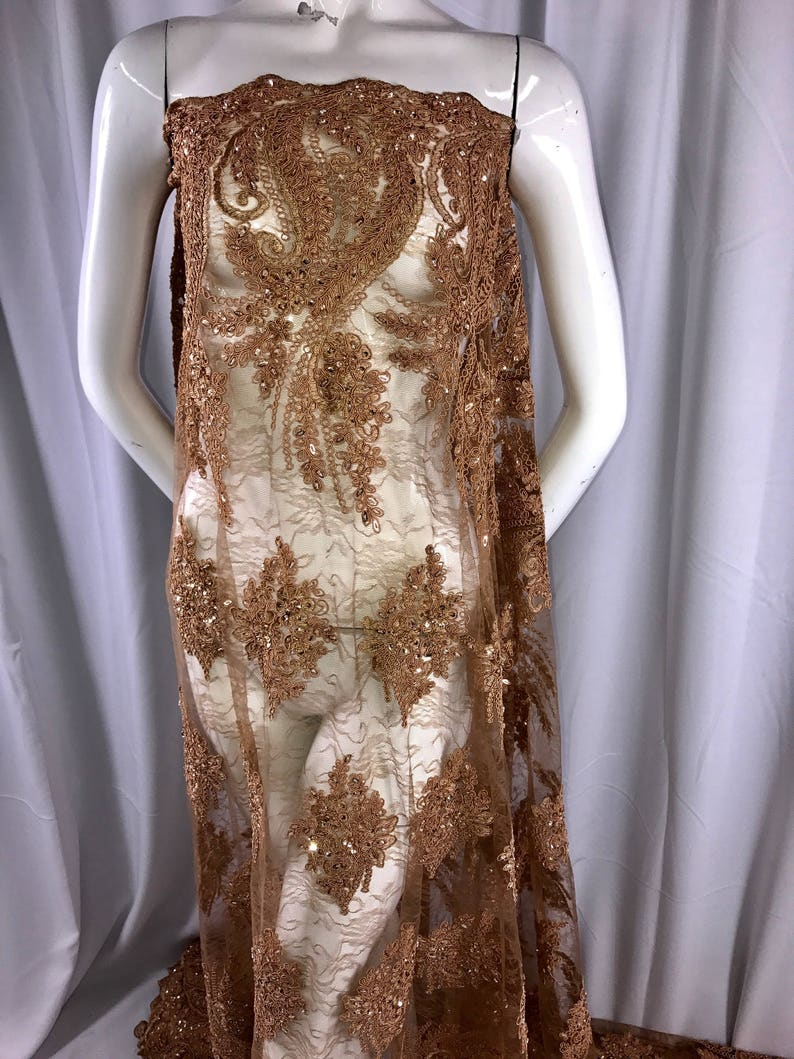 Dark skin color floral design embroidery and hand beaded with beads and shiny sequins on a pattern mesh-dresses-fashion-sold by the yard.