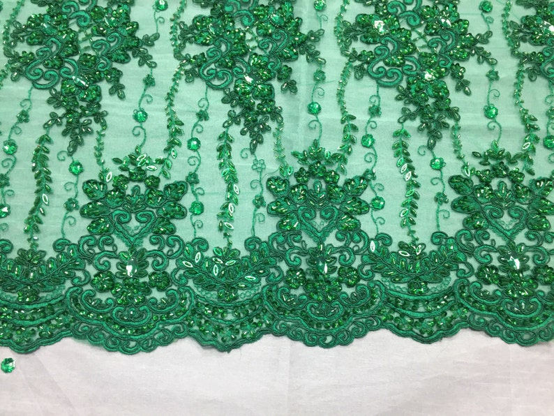 yard Green magnificent design embroider and heavy beaded on a mesh lace