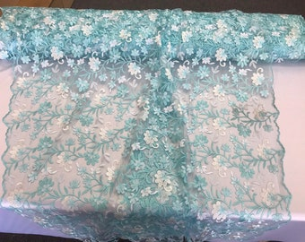 Light blue/white multi color floral design embroidery on a mesh lace-dresses-fashion-apparel-prom-nightgown-sold by the yard.