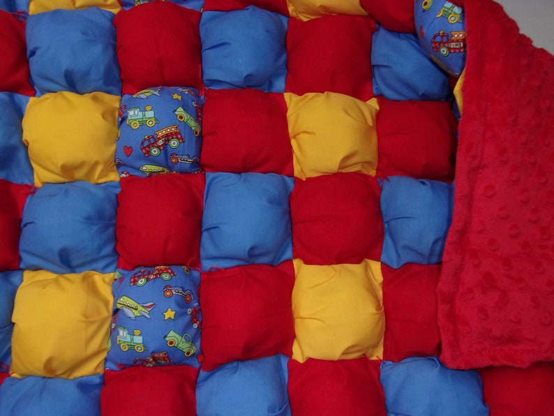 with red fleece minky on back and border by PerfectGiftPuffQuilt one of a kind baby crib size 28 x 42 cotton puff quilt vehicle print