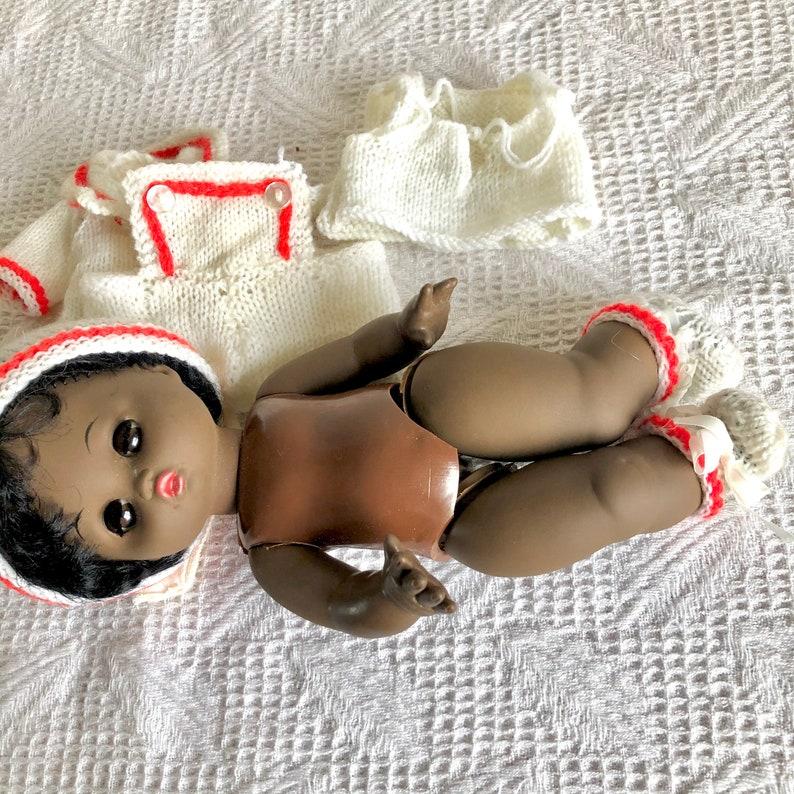 Black plastic vintage doll needs repair