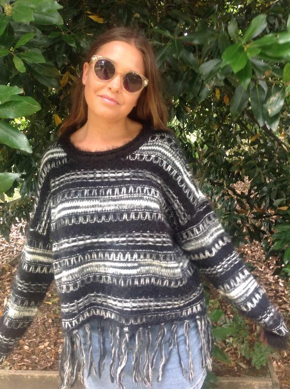 black sweater white sweater black pullover white pullover fringed sweater pullover with fringe short pullover. Black white sweater