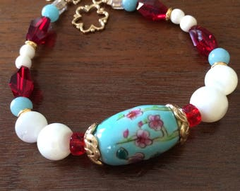 Chinese porcelain, mother of pearl, and crystal bracelet