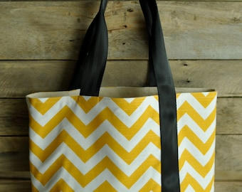 Large, sturdy, canvas,  yellow & white chevron tote bag.  Seat belt strap.  Market bag, carry on, book bag, multi-purpose