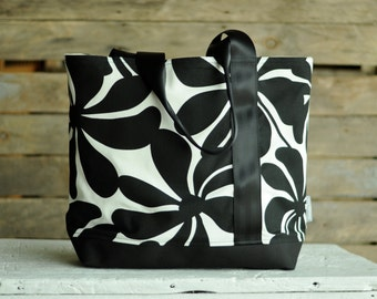 Large, sturdy, canvas, black & white floral tote bag.  Seat belt strap.  Market bag, carry on, book bag, multi-purpose