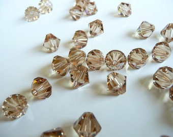 Ten (10) Swarovski 5301 6mm Bicone Crystals - Light Colorado Topaz