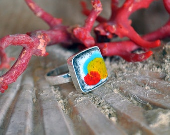 Fencing-Handcrafted silver ring-banded ring with Raku stone enamelled in the colours of red, yellow, turquoise.