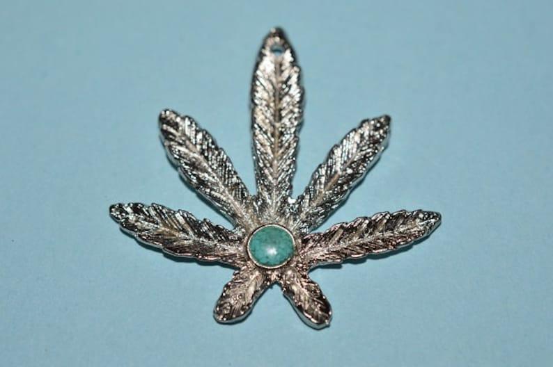 1060340 - MP2-2-02 Vintage Inlaid Turquoise Colored Center Marjuana Leaf  pendant