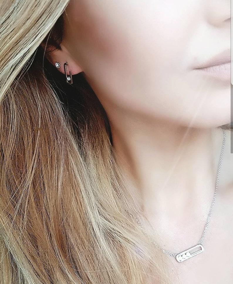 The Gigi Crystal Drop Earrings plain surround
