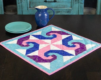 Mini quilt in aqua, blue and pink with a touch of shimmer!