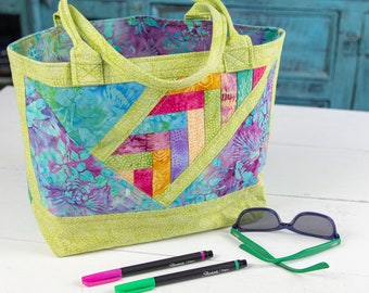 Quilted small tote bag in green batik cotton fabrics with blue and magenta florals.