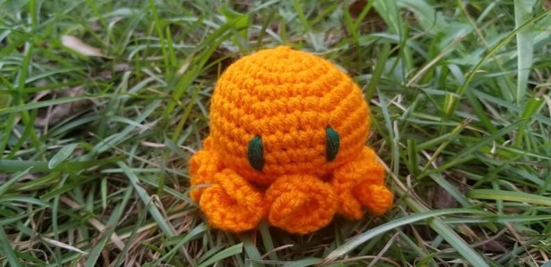 Orange Amigurumi Cthulie crochet toy spellball