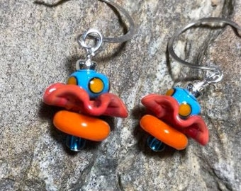 Polka dotted orange and blue lampwork earrings with gorgeous orange ruffle bead hanging on handmade sterling round wires.