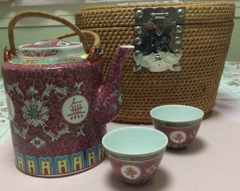 Chinese teapot and cups in warming basket