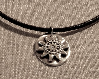 Fine Silver Oval Disc with a Sun or Flower | Precious Metal Clay
