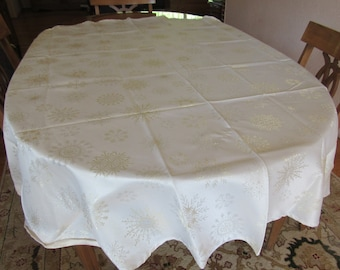Round Holiday Tablecloth, 70 Inches Across With Gold and Silver Snowflake Designs