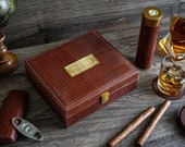 Personalized leather humidor box gift set with matching accessories.