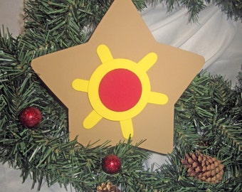 Staryu Pokemon Christmas Tree Topper -- wood painted brown, yellow, and red; 8 inch star