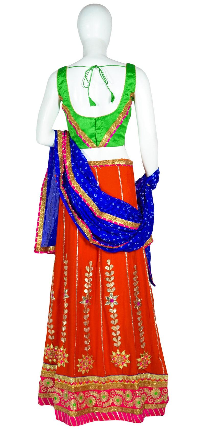 Indian Orange Crepe Silk Lehenga with Gota Patti work and Pink border Blue Bandhini Dupatta and Green Blouse for Navratri