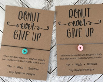 Donut Wish Bracelet on a 1mm wax cotton cord. Includes a hand painted, enamel donut charm blue or pink frosting. Donut give up keepsake card