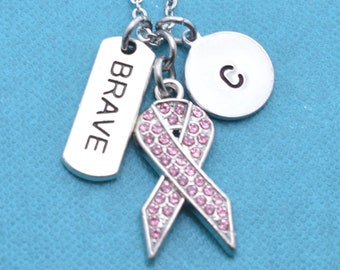 """Breast cancer awareness necklace in silver metal and pink crystals with """"Brave"""" word charm. Breast cancer gifts. Breast cancer jewelry."""