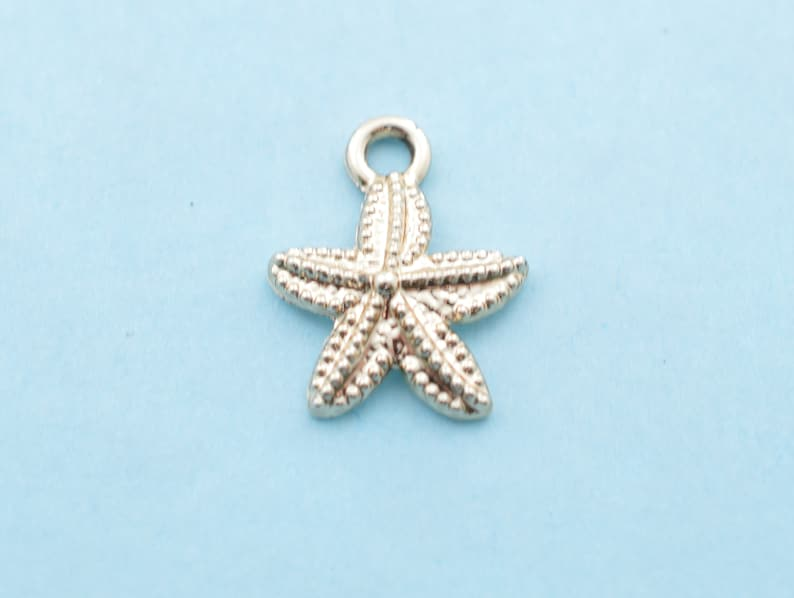 Ocean Water I must go/' word tag with gold toned starfish pendants on a stainless steel chain Woman/'s necklace /'the sea is calling.. Sun.