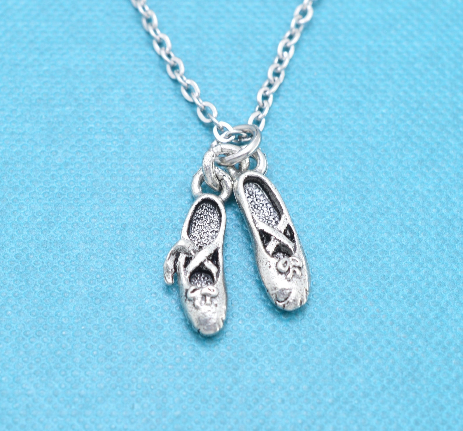 little girl's ballet slippers necklace in silver pewter on a 14