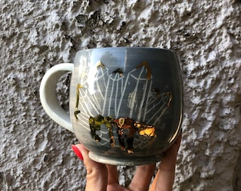 Crystal mug, carved crystals, gold detail