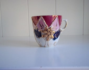 Hand painted Antique German Lusterware Molded Demitasse Tea Cup, Pink, Purple and Red Luster with Gold Detail