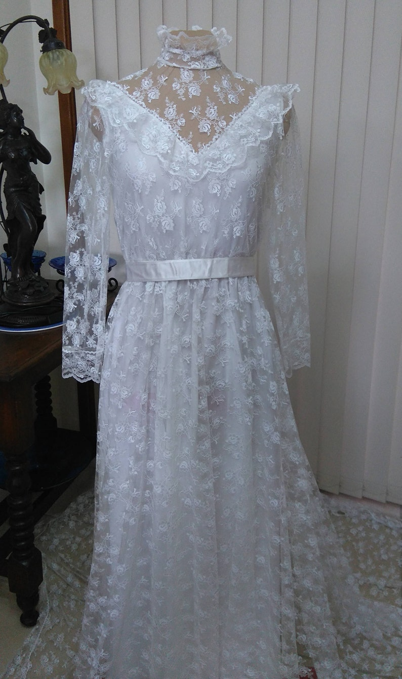 Vintage long sleeve lace bridal gown and veil
