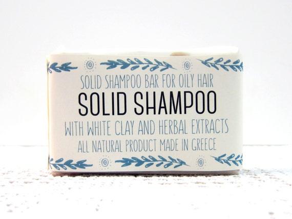 Shampoing à base de plantes. Fait à la main au savon shampooing solide avec du miel et huiles essentielles