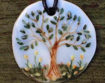 Handmade fine porcelain pendant with hand painted spring/summer scene of tree and flowers. A beautiful gift and uplifting to wear.