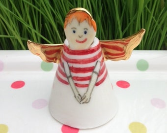 Porcelain Angel ornament, beautiful little character ,hand painted with gold lustre wings. Angels are for any occasion, a special gift!