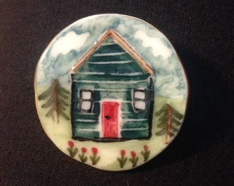 Porcelain Cabin in the woods brooch, lovely gift for shed and allotment lovers! Hand painted , this is feel good piece of jewellery !