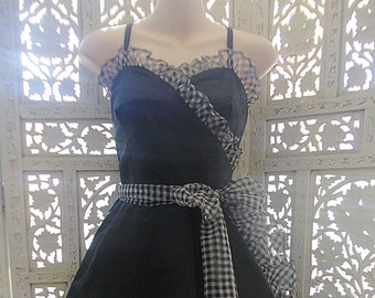 Early 80s black taffeta and black/white check organza bias frilled party dress with shoulder straps, flared skirt with faux wrapover front.