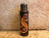 The Lizard Clipper A hand crafted Copper Case featuring a polished relief of a lizard sealed in lacquer