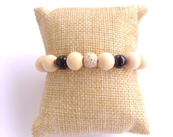 Cream colored lava stone beaded wooden aromatherapy bracelet