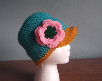 e9a7acba5cc Bright colors beanie with flower and bill.