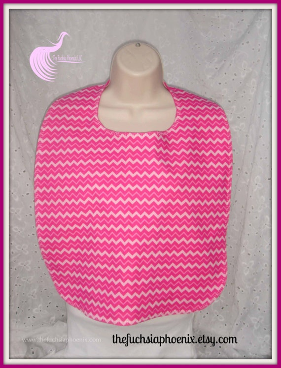 Valentine expressions on a bright pink background adorn this full lap bib for adultsteens